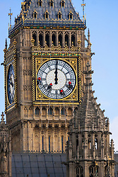 London, August 18th 2014. Abseilers hang high above Parliament as they clean the glass on the clock face on Elizabeth Tower, commonly known as Big Ben, which is in fact the name of the bell that chimes the hours.