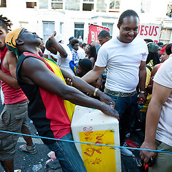 London, UK - 26 August 2013: a man dances with a traffic divider during the  annual parade at the Notting Hill Carnival.