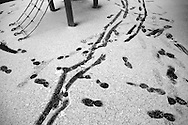 Children's footsteps and scooter tracks mark a snow covered school playground in Berkhamsted, England   Thursday Jan. 29, 2015. Children and mothers inhabit a strange place that until a few years ago I didn't know existed. Even as I child I was oblivious to it. Now my days are spent with costumed Storm Troopers patrolling my hallways. My evenings are filled with dinners and bath times and bedtime reading and tantrums and so much else. This is my new normal, and taking pictures makes me stop and look.