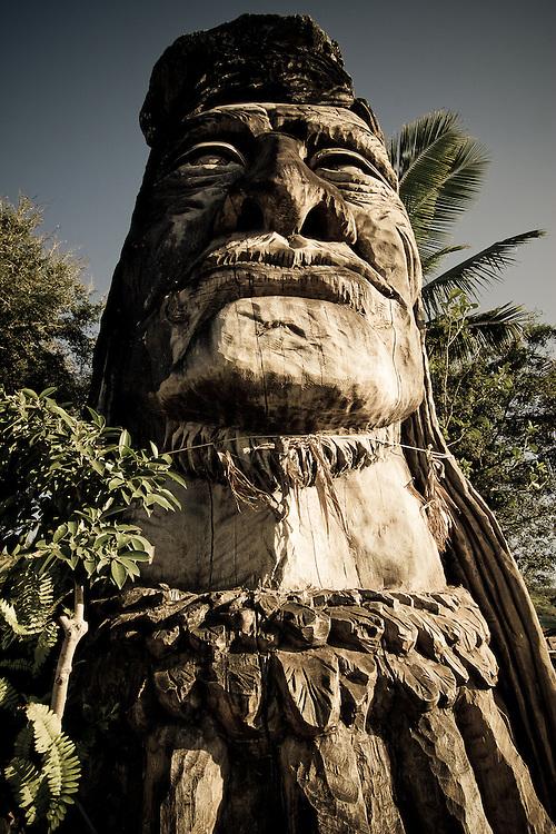 A wooden statue, Maui Pohaku Loa, stands tall at the north shore, Oahu, Hawaii, USA.