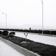 A man walks in a newly constructed bridge at the Three Gorges Dam near Yichang