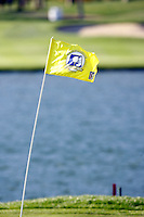 25 January 2009: Wind gusts 15-30 mph in the afternoon. Yellow flag in the 18th hole at Palmer Private at PGA West in La Quinta, California during the fifth round of play at the 50th Bob Hope Classic, PGA TOUR golf tournament.