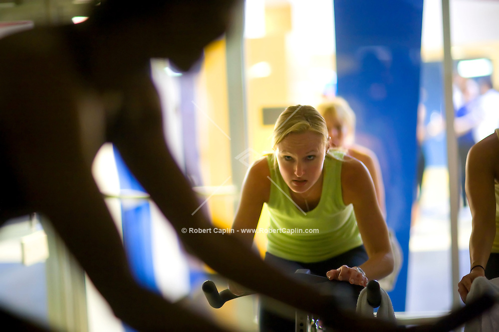 Katie Wibling during a spin class at New York Sprots Club, May 29, 2008. Photographer: Robert Caplin For The New York TImes..