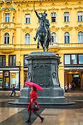Josip Jelacic Statue and woman with red umbrella, Jelacic Square, Zagreb, Croatia