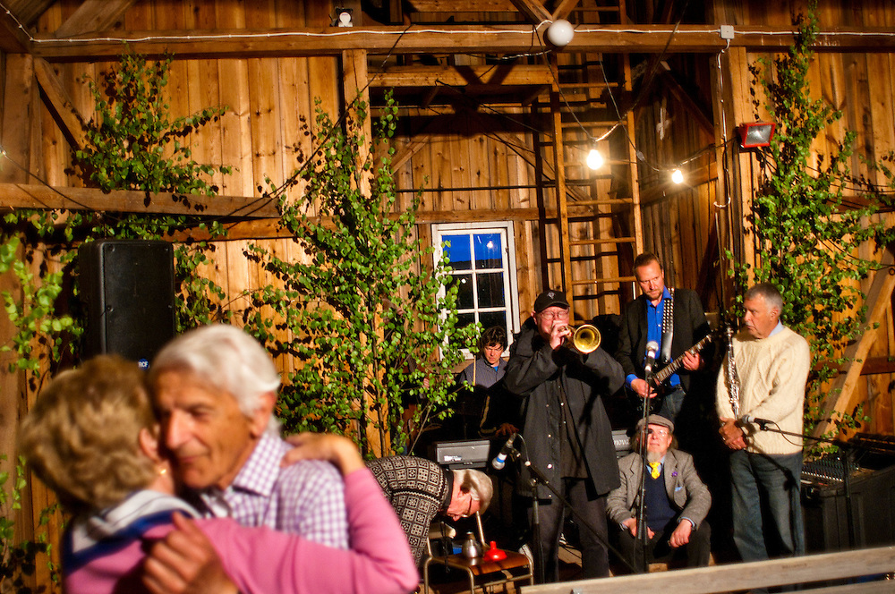 Birgitta Erson and Helge Brøms dancing in the old fire station  during the village party in Västanvik, Sweden
