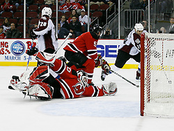 Feb 26, 2009; Newark, NJ, USA; New Jersey Devils goalie Martin Brodeur (30) sprawls to make a save after being knocked down during the third period at the Prudential Center. The Devils defeated the Avalanche 4-0.