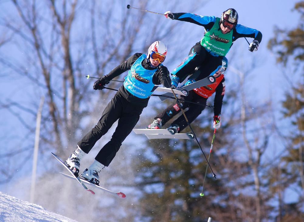 IMG_1199.CR2 -20110211- Collingwood, Ontario,Canada -- Egor Korotkov of Russia, left,  Amaud Bovolenta of France and his teammate Sylvain Miaillier catch some air during their quarter final race of the Rockstar Ski Cross Grand Prix event at Blue Mountain in Collingwood, Ontario, February 11, 2011.<br /> AFP PHOTO/Geoff Robins
