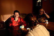 Windsor, Canada. January, 2013. 'Idle No More' participants relax  at OPIRG House after a Round Dance event at the University of Windsor.