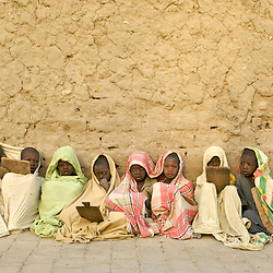 Children memorize the Koran on tablets in the early morning chill at a Koranic School in Timbuktu, Mali March 11, 2007. , Children memorize the Koran on tablets in the early morning chill at a Koranic School in Timbuktu, Mali March 11, 2007.