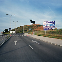 A for sale sign next to the spanish bull figure, Guadalajara, Spain.