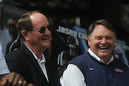 Ole Miss Sports Information Director Langston Rogers and head coach Houston Nutt during Grove Bowl pre-game activities in the Grove at the University of Mississippi in Oxford, Miss. on Saturday, April 17, 2010.