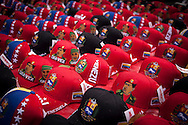 Baseball Caps with the image of President Hugo Chávez in a street stall in Los Proceres, Caracas, Venezuela, 12th March 2013. During Hugo Chávez funeral many people and stand sold miscellaneous articles that perpetuate Chávez presence. Everything from T-shirts, badges, earrings, baseball caps, sun glasses seemed suitable to have the President's image. The cult of Chávez is now more alive than ever.