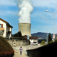 School child going home for lunch in a town close to G&ouml;sgen Nuclear Power Plant (Kernkraftwerk G&ouml;sgen), with smoke rising from its cooling tower. <br /> The Swiss are due to vote shortly in a referendum whether to quit nuclear power, which via its five reactors, on four sites, provide almost 40% of the country's power