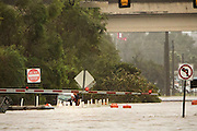 An unidentified woman is rescued from her vehicle which is floating in waist-deep water on flooded President Street after Hurricane Matthew caused flooding along the east coast of Georgia, Saturday, Oct. 8, 2016, in Savannah, Ga. (AP Photo/Stephen B. Morton)