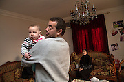 CAIRO, EGYPT - FEBRUARY 25: Al Jazeera English (AJE) producer Baher Mohamed (c) entertains his infant son Haroun along with his wife Jehan February 25, 2015 at their family apartment in the Sheikh Zayed district on the outskirts of Cairo, Egypt. Haroun was born while Baher was being detained in an Egyptian prison for more than 12 months last year.  (Photo by Scott Nelson, for the Washington Post)