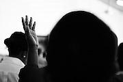 A woman prays during Sunday service at the Eglise de la Communauté Evangélique de Haiti.