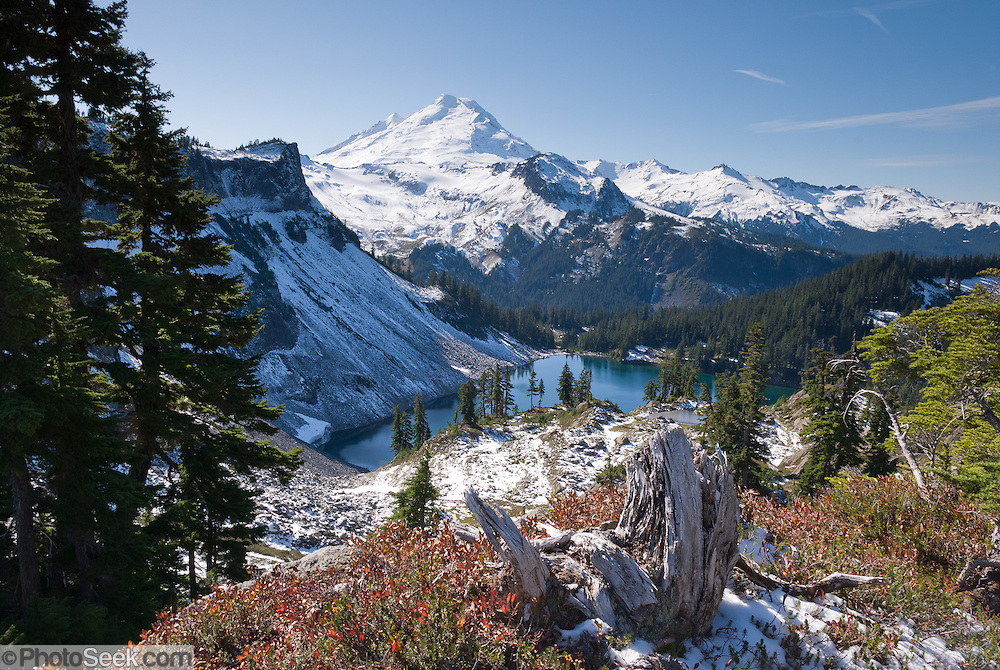 From the Chain Lakes Loop trail at Herman Saddle in Mount Baker Wilderness, view Mount Baker (10,781 feet elevation) and Iceberg Lake, Whatcom County, Washington, USA