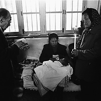 DONGLU, 11 MARCH 2001: Bishop Su (L) , baptizes a baby girl after mass.<br />