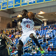 """Delaware 87ers Forward Keith """"Tiny"""" Gallon (41) grabs a defensive rebound in the first half of a NBA D-league regular season basketball game between Delaware 87ers (76ers) and the Erie BayHawks (Knicks) Friday, Jan. 3, 2014 at The Bob Carpenter Sports Convocation Center, Newark, DE"""
