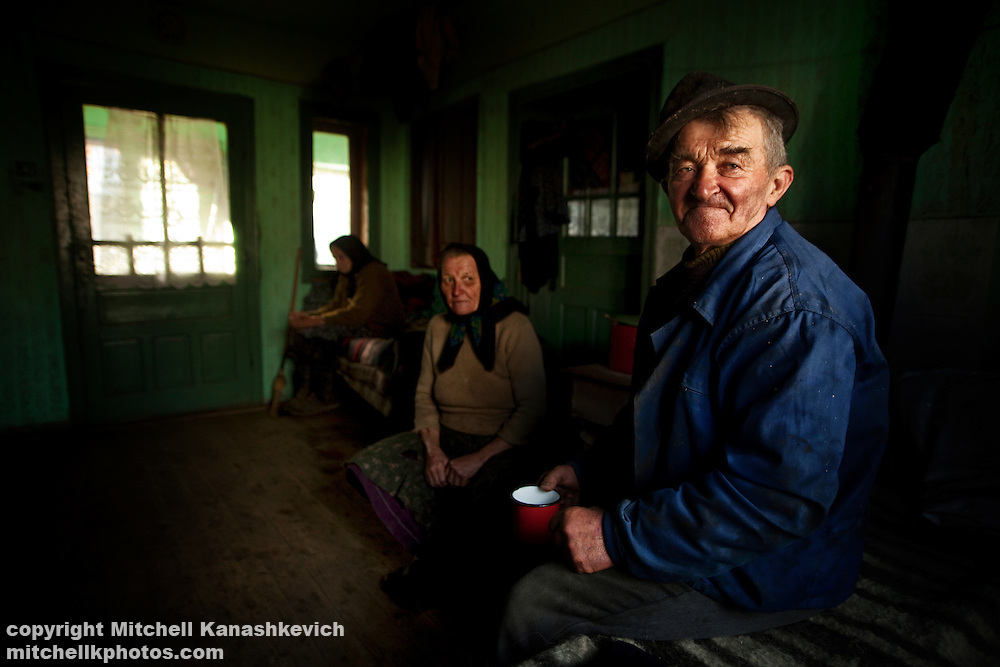 Husband, wife and mother in law in a traditional house in the countryside of the region of Maramures