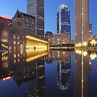 Boston cityscape and skyline night photography showing landmarks such as the Prudential Center, The First Church of Christ and 111 Huntington Avenue office building on Memorial Day weekend in 2013. The magical twilight and building reflection is captured in the pool of the Christian Science Plaza in the Back Bay neighborhood of Boston.   <br />