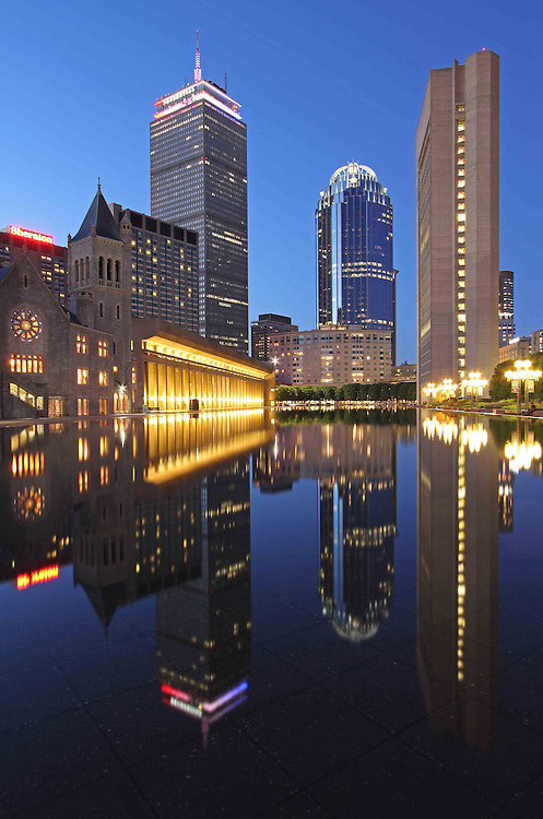 Boston cityscape and skyline night photography showing landmarks such as the Prudential Center, The First Church of Christ and 111 Huntington Avenue office building on Memorial Day weekend in 2013. The magical twilight and building reflection is captured in the pool of the Christian Science Plaza in the Back Bay neighborhood of Boston.   <br /> Photographs of Boston are available as museum quality photography prints, canvas prints, acrylic prints or metal prints. Prints may be framed and matted to the individual liking and decorating needs: <br /> <br /> http://juergen-roth.artistwebsites.com/featured/prudential-center-at-night-juergen-roth.html<br /> <br /> Good light and happy photo making!<br /> <br /> My best,<br /> <br /> Juergen<br /> Prints: http://www.rothgalleries.com<br /> Photo Blog: http://whereintheworldisjuergen.blogspot.com<br /> Twitter: @NatureFineArt<br /> Facebook: https://www.facebook.com/naturefineart