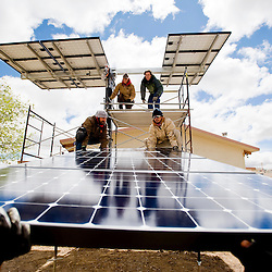 052011       Brian Leddy.A crew from Positive Energy installs solar panels at the Crownpoint Chapter House on Friday morning. With the addition of the solar panels the, chapter house will now gather it's electricity solely from the sun.
