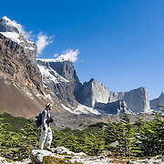 The granite rock tower of Cerro Catedral rises in French Valley (Valle Frances) in Torres del Paine National Park, Chile. The foot of South America is known as Patagonia, a name derived from coastal giants, Patagão or Patagoni, who were reported by Magellan's 1520s voyage circumnavigating the world and were actually Tehuelche native people who averaged 25 cm (or 10 inches) taller than the Spaniards.