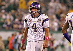 Oct 11, 2010; East Rutherford, NJ, USA; Minnesota Vikings quarterback Brett Favre (4) walks off the field after losing 29-20 to the New York Jets at the New Meadowlands Stadium.