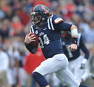 Mississippi quarterback Bo Wallace (14) runs 28 yards for a touchdown against Troy at Vaught-Hemingway Stadium in Oxford, Miss. on Saturday, November 16, 2013. (AP Photo/Oxford Eagle, Bruce Newman)