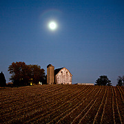 A collection of Barns that still can be seen while traveling the countryside in  the beautiful State of Wisconsin.<br /> Dane County- Barn and full moon on Hwy M near Gov. Nelson State Park.