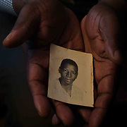 February 05, 2003 - Chad Debnam with an old photo of his brother Clarence Debnam Jr. who was killed many years ago by a shotgun blast.