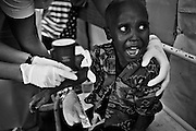 A young boy about to be re-hydrated with intravenous fluids at the admissions and screening section of the Cholera Treatment Centre in Harare...Children and adults are treated at Beatrice Road Infectious Diseases Clinic in Harare, Zimbabwe...The clinic is staffed by locals but assisted by MSF.