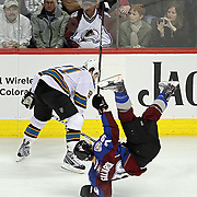 DENVER, CO - APRIL 24 : TJ Galiardi #39 of the Colorado Avalanche gets upended on an open ice check by Scott Nichol #21 of the San Jose Sharks in the first period of Game Six of the Western Conference Quarterfinals during the 2010 NHL Stanley Cup Playoffs at the Pepsi Center on April 24, 2010 in Denver, Colorado. (Photo by Marc Piscotty / © 2010)