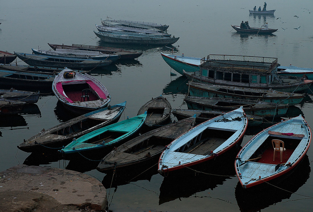 A couple of boats cross the Ganges river on the early morning on January 31, 2013 in Varanasi, India. — © Jeremy Lock/
