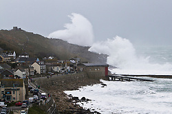 © Licensed to London News Pictures. 08/02/2014. Sennen, UK. Waves crash over cliffs at Sennen Cove, Cornwall,  as strong winds start to batter the West coast of England.. Photo credit : Ashley Hugo/LNP
