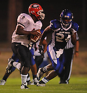Water Valley's Quinterrio Bailey (24) makes a tackle vs. Coffeeville in Water Valley, Miss. on Friday, August 26, 2011.
