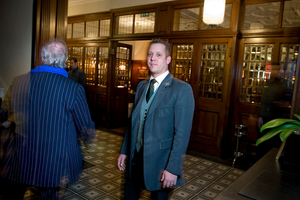 UK. London. Ashley Harman, chief Concierge at Brown's Hotel in Mayfair. Photo shows Ashley inside the hotel and outside with the hotel in the background..Photo by Steve Forrest..