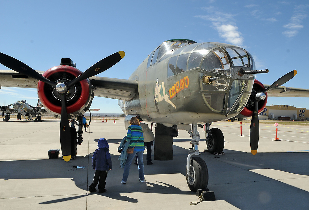 jt040517g/a sec/jim thompson/ People checking out the B-25J Mitchell on the Cutter Aviation tarmac as the four planes of the Wings of Freedom Tour is in Albuquerque Wednesday April 5th-7th.  April 05, 2017. (Jim Thompson/Albuquerque Journal)