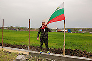 Dinko Valev at his new junkyard in Yambol, Bulgaria. Valev embracing the Bulgarian flag.<br /> <br /> Matt Lutton / Boreal Collective for VICE