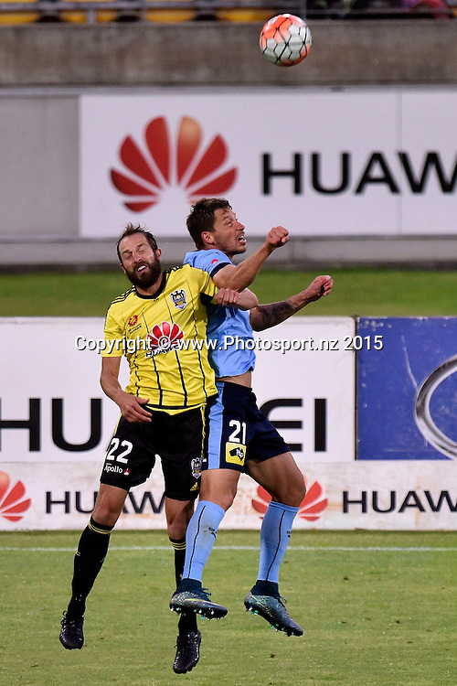 Andrew Durante (L) captain of the Phoenix jumps for the ball with Filip Holosko of Sydney FC during the A-League - Wellington Phoenix v Sydney FC football match at Westpac Stadium in Wellington on Sunday the 19th of December 2015. Copyright Photo by Marty Melville / www.Photosport.nz