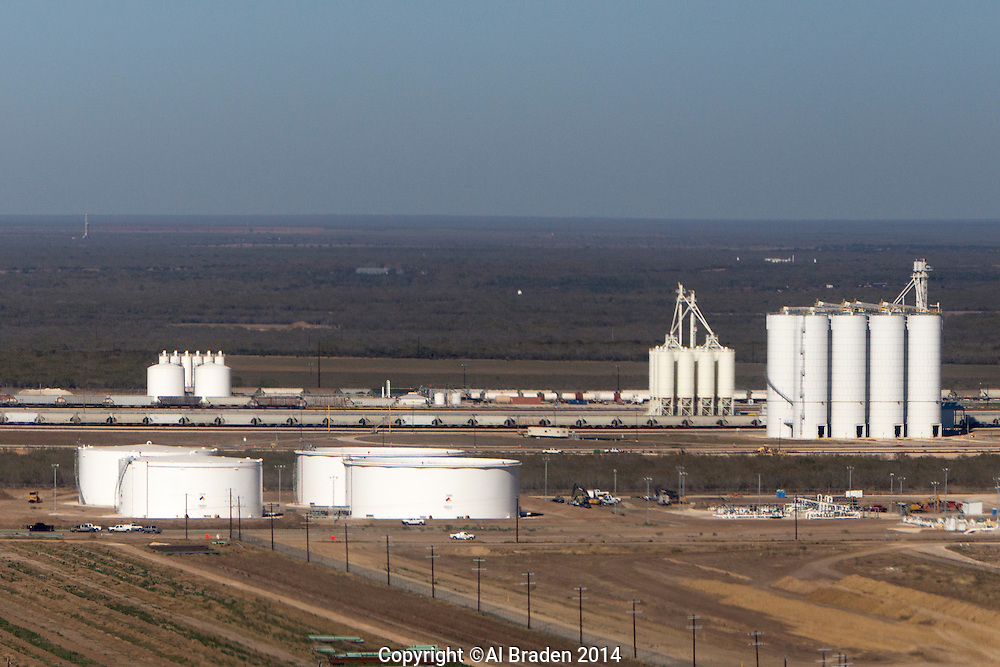 Gardendale Rail Terminal. Fracking sand silos on right, Plains All American Oil tanks left foreground.