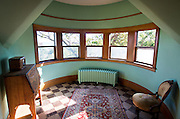 MADISON, WI — SEPTEMBER 2: The third floor of Buell House at 115 Ely Place features a rounded turret sunroom with views out over Lake Mendota.