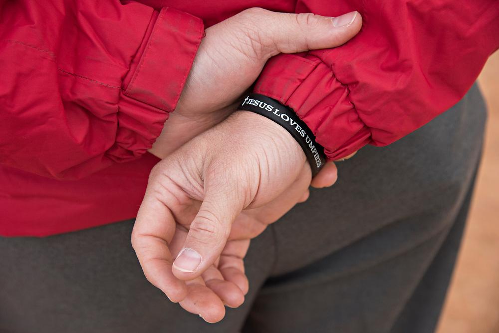 DAYTONA BEACH, FL - JANUARY 5, 2016:  A bracelet on an instructor at the Wendelstedt Umpire School declares Jesus Loves Umpires. (Photo by Melissa Lyttle)