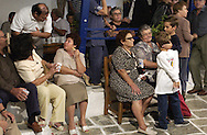 Ios residence and supporters of Mayor George Poussaios celebrate his reelection on the island of Ios, Greece on October 11, 2002. Poussaios has been the mayor of the island of Ios since 1990. Photo by Jakub Mosur