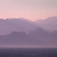 Huge, hazy mountain range over Mediterranean sea west of Antalya.