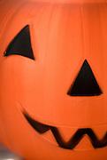 Bright orange plastic Halloween jack-ol-lantern.