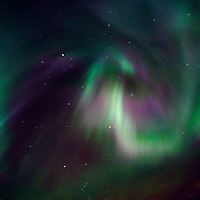 A vivid auroral display hovers above the Independence Gold Mine in Hatcher Pass, Alaska, on December 14, 2006.