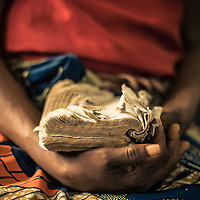 Sometimes the only thing people could rely on was their faith. This well worn bible shows this woman's story. Mwene-Ditu, DRC.
