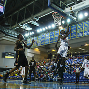Delaware 87ers Forward Damian Saunders (18) drives towards the basket in the first half of a NBA D-league regular season basketball game between Delaware 87ers (76ers) and the Erie BayHawks (Knicks) Friday, Jan. 3, 2014 at The Bob Carpenter Sports Convocation Center, Newark, DE